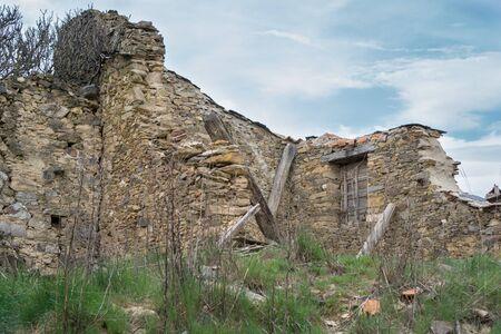 joist: Ruined house against blue sky