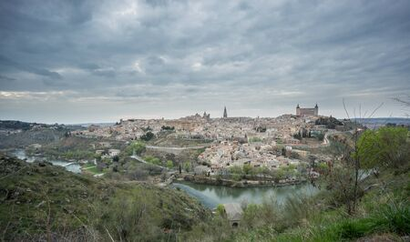 cloudy sky: Wide angle view of Toledo with cloudy sky