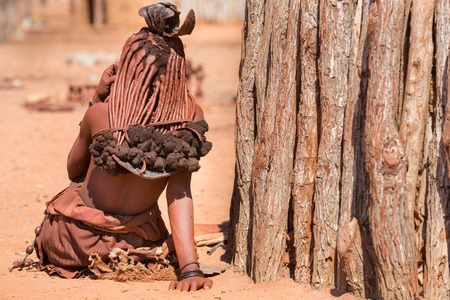 shack: Rear view of himba woman outside shack Stock Photo