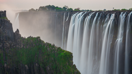 Victoria Falls sunset, long exposure view from Zambia with rocks