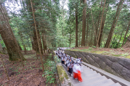climbing stairs: Wide view of blurred pupils visiting Japanese temple, climbing stairs