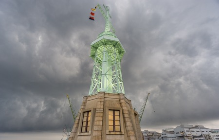 stormy clouds: Bottom view in wide angle of lighthouse in Kobe under stormy clouds, Japan