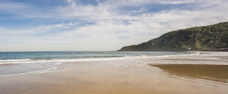 surfers: Wide angle view of many surfers in the Beach of San Sebastian, Spain