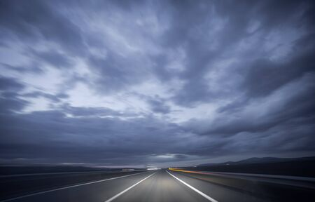 blurred motion: Wide angle view of car driving during night, blurred motion Stock Photo