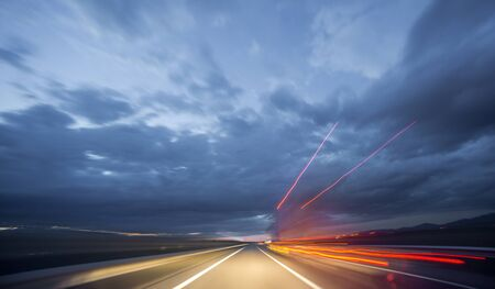 ''wide angle'': Wide angle view of truck driving during night, blurred motion