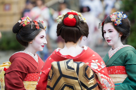 maiko: KYOTO, JAPAN - JUNE 10: Unidentified tourist women dress like a Maiko, Tourists usually makeup as Geishas (also known as Maiko) in Kyoto on June 10, 2015 in Japan