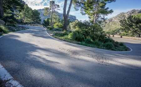 lonelyness: Wide angle view mountain with U-shape curved road Stock Photo