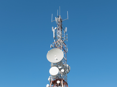 communication tower: Isolated view of communication tower over blue sky
