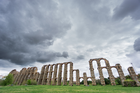 buttresses: Ultra wide view of Aqueduct of the Miracles in Merida against stormy sky, Spain Stock Photo
