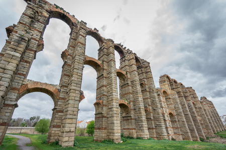 buttresses: Ultra wide perspective view of Aqueduct of the Miracles in Merida against stormy sky, Spain