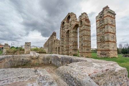 acueducto: Ultra wide perspective view of Aqueduct of the Miracles in Merida against stormy sky, Spain