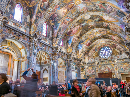 renewed: VALENCIA, SPAIN - FEBRUARY 28: Unidentified tourists enjoy a tour inside St. Nicholas Chapel (also known as Valencian Sistine Chapel) on February 28, 2016