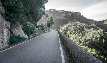 lonelyness: Wide angle view mountain road Stock Photo