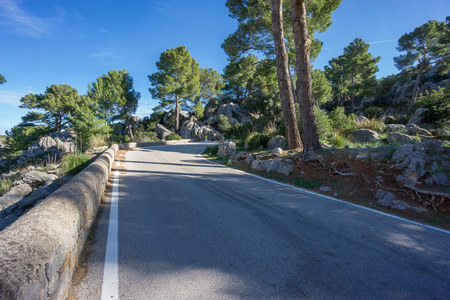 lonelyness: Wide angle view mountain road with curve Stock Photo