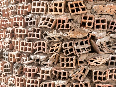 faulty: Front view of wall made of faulty bricks Stock Photo