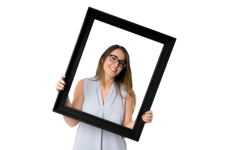 Black frame and woman with glasses holding it Imagens