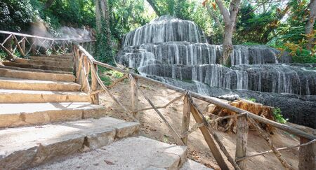 descending: Wide angle view of waterfall and descending stairs at Monasterio de Piedra in Spain, long exposure