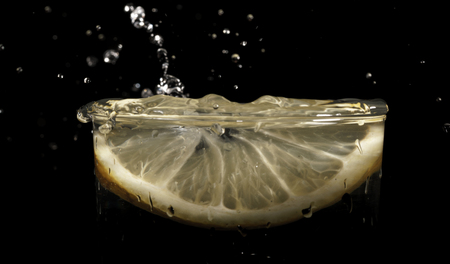 lemon wedge: Water drops, glass of water, slice of with lemon Stock Photo
