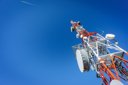 detailed view: detailed view of communication tower over blue sky