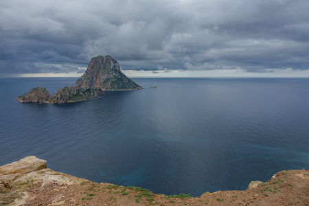 vedra: Storm over picturesque and mysterious island of Es Vedra. Ibiza, Balearic Islands. Spain