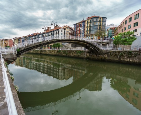 Old brige in downtown Bilbao with nervion river