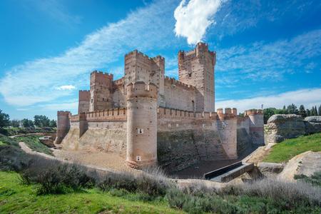 Wide angle view of corner of Castillo de la Mota in Medina del Campo with blue sky, Castille, Spain