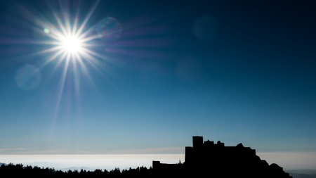 Medieval castle of Loarre backlit and sun in Huesca, Spain