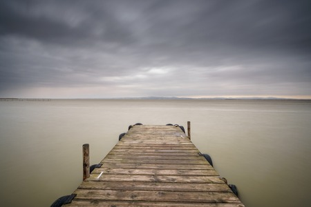 Storm over Albufera with wooden pier, Valencia