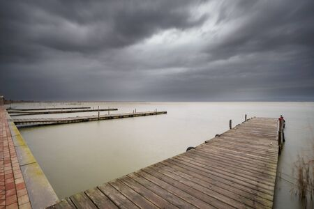 path to romance: Storm over Albufera with piers in perspective, Valencia