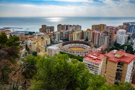 corrida de toros: Wide angle view of Malaga city and bullfight arena near mediterranean sea