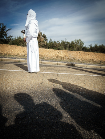penitence: Easter traditional procession in brotherhood with shadows