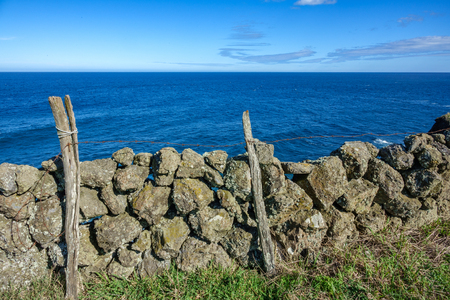 Stone volcanic wall near ocean
