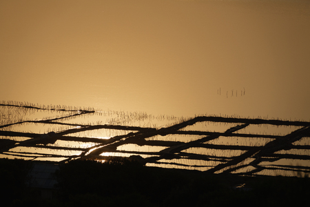 smal: Long shot of saltmine at sunset
