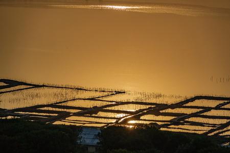 Long shot of saltmine at sunset