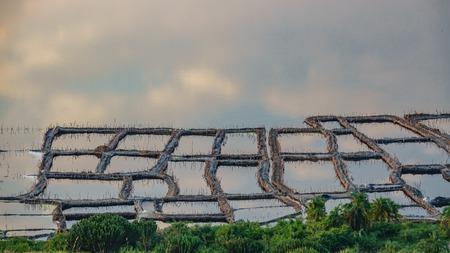 Long shot of saltmine at dusk Stock Photo