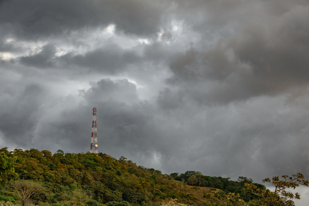 Communication tower at top of mountain with clouds