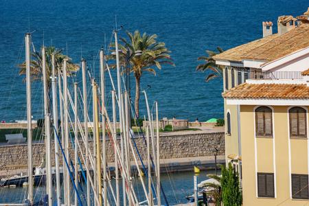 Sailing ship masts, houses and sea Stock Photo