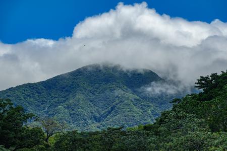 Rincon de la vieja vulcano and misty clouds