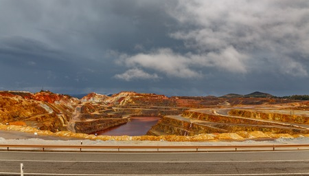 Rio Tinto mine and road on stormy day, wide angle