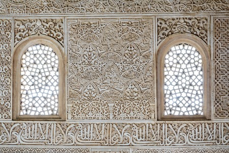 Decorated tiles with geometric shapes and windows, the Alhambra Stock Photo