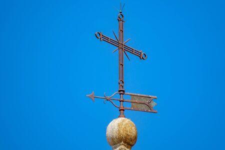 Rusty iron cross on top of church Stock fotó