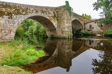 River and medieval bridge in Allariz, side view