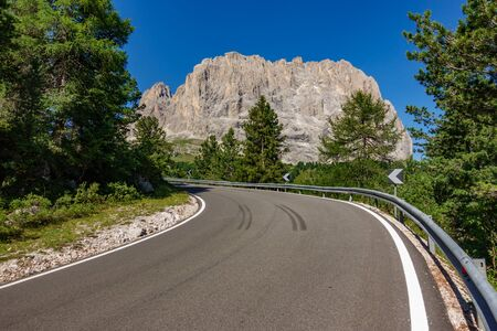 Picturesque road and landmark in the Sella Pass, Dolomites