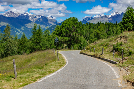 Mortirolo pass road with mountain peaks