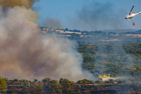 Fire in the wilderness with plane and helicopter