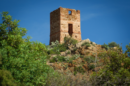 Antique stone tower over hill