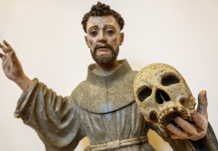 Wooden holy figure holding skull with woodworm Stok Fotoğraf