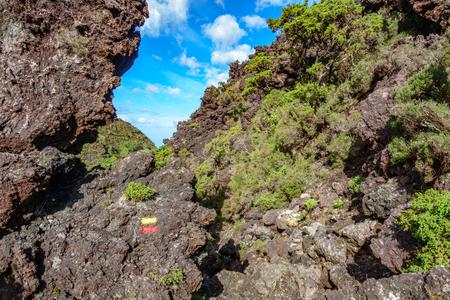 Track across volcanic rocks zone Stock Photo
