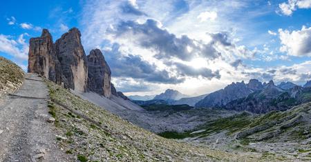 Tre Cime di Lavaredo rocks big panorama at sunset with track Stock Photo