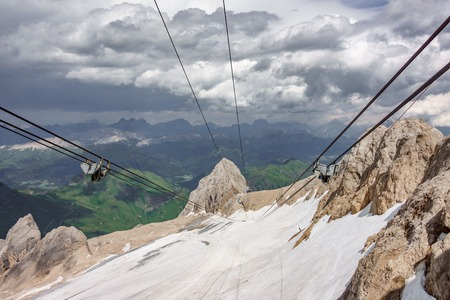 Cable car cables and wheels against vertical rock, Marmolada Peak Stock Photo